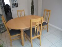 Extending Table and four upholstered chairs