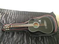 Madina acoustic guitar like new with case and extar strings
