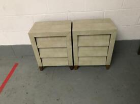 Two matching bedside cabinets in green glass