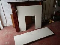 Wooden sorround and cream marble back panel and hearth