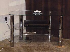 Glass and chrome tv unit . Solid item.
