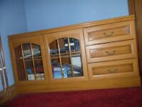 TELEVISION CABINET - CAN BE USED FOR OTHER THINGS WITH ITS GLASS FRONTED DISPLAY AND THREE DRAWERS.