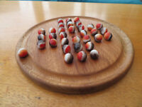 Hardwood Solitaire board and marbles