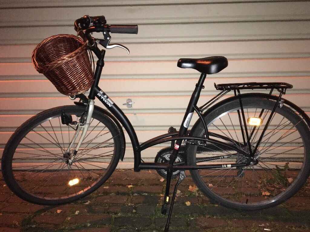 Danish style city bike (it comes with basket and baggage rack)