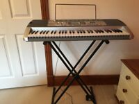Casio light up keyboard and stand