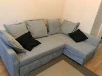 IKEA L-shaped 1-year old grey Holmsund sofa bed, very good condition