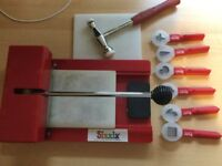Sissix die cutting machine and 6 sissix paddle punches with hammer.