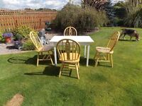 EXCELLENT WHITE DINING TABLE AND FOUR PINE CHAIRS.