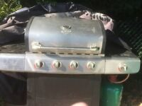 UniFlame BBQ and side burner for keeping saucepans warm
