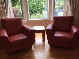 Natuzzi terracotta leather armchairs