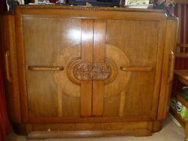 Art Deco style sideboard/drinks cabinet. Shelf and drawers inside. Side opening drinks cupboard.