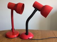 Red table or bedside lamps with flexible stems.
