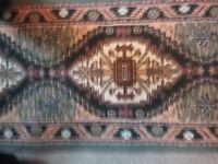 Pair of Belgian made rugs. 220cm x 60cm each.