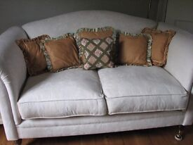 set of matching cushions with one feature cushion all with feather pads