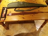 Shot gun belt, carry case and cleaning kit.