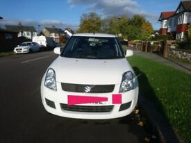 2008 White Suzuki Swift
