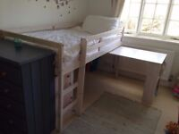 mid-sleeper bed in washed white with two shelving units and pull out desk.