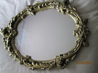Antique style oval gilt mirror
