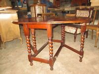Wooden dining room table with barley twist legs