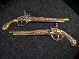 A pair of Brass Pistols. Made in England.