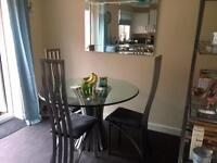 Glass dining table, 3 chairs & shelving unit