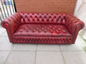 A Vintage Oxblood Red Leather Chesterfield Buttoned Sofa