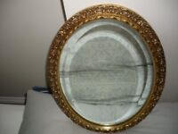 Oval bevelled edge Glass Mirror with an intricate gold frame & a Framed Monet Print