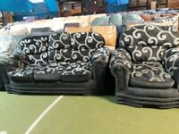 dark grey with light grey pattern 3 seater sofa and 1 armchair