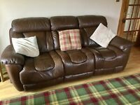 2 DFS sofas in brown leather with recliners.