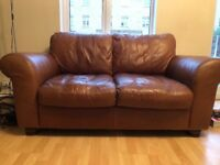 Brown leather two seater leather sofa/couch.