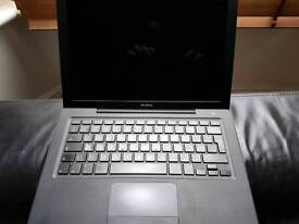 MacBook 2008 black dual core 2gb ram 200gb disk