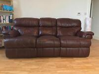 Dark brown sofa with extension.