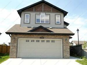 EXECUTIVE 2-STOREY HOME WITH DOUBLE GARAGE IN WINDERMERE