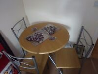 Wood and Metal table with four chairs