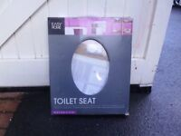 TOILET SEAT (NEW....and still wrapped...)