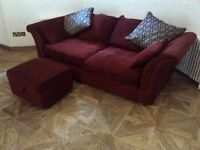 very large sofa with footstool and some pillows all in deep red very good condition