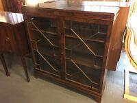 Dark wood veneer glass cabinet