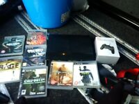 ps3 500gb super slim with new controller and 7 games