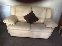 Two seater leather sofa. Excellent condition