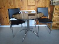 Round glass table and two chairs