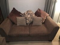 Brown fabric sofa with foot stool