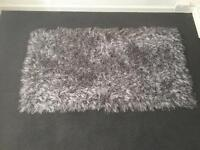 Grey thick rug