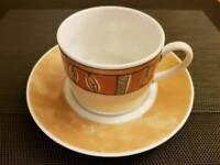 Coffee / tea cup with saucer