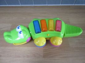 Piano crocodile - with music, lights, shakers and instrument bits!