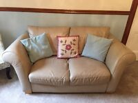 2 X two seater cream leather sofas (used)