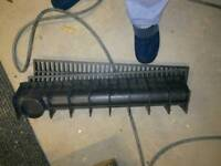 Drainage channel with grate