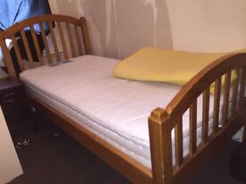 Wooden single bed and mattress