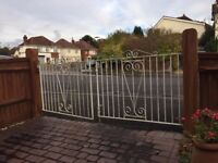 Pair of white iron gates
