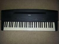 Yamaha YPR-30 Portable Digital Piano including folding stand and power adapter.