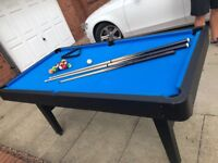 6ftX3ft Pool table and accessories. Balls, chalk, 2 adult cues, one small cue. Very good condition.